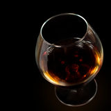 Glass of cognac isolated Royalty Free Stock Image