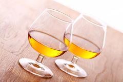 Glass of cognac over wooden surface Stock Photo