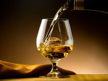 Glass of cognac Stock Photos