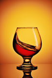 Cognac splash Royalty Free Stock Photos