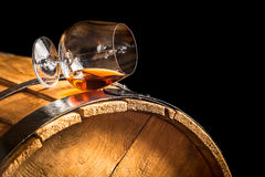 Glass of cognac on the vintage barrel Royalty Free Stock Images
