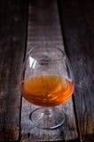 Glass of cognac Stock Photos