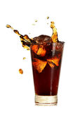 Glass of coke. With ice cubes and splash isolated on white Stock Photos