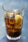 Glass of coke. With ice and lemon Stock Images