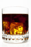 Glass of Cola. Closed-up of glass of Cola and ices with isolated white background Stock Image