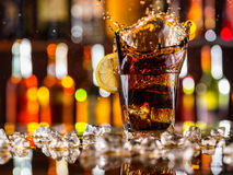 Glass of cola on bar counter Stock Photography