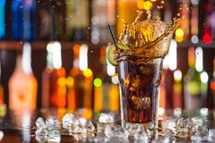 Glass of cola on bar desk Stock Image