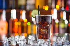 Glass of cola on bar desk Stock Photos