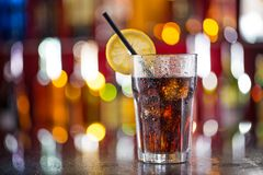 Glass of cola on bar desk Stock Images
