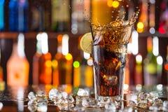 Glass of cola on bar desk Stock Photos