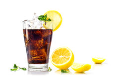 Glass of cola or coke with ice cubes, lemon and peppermint garni Royalty Free Stock Photography