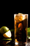 Glass of cola or coke with ice cubes, lemon slice Royalty Free Stock Image