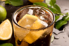 Glass of cola or coke with ice cubes, lemon slice Stock Photography
