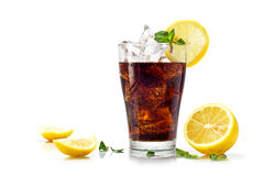 Glass of cola or coke with ice cubes, slices of lemon and pepper Stock Photos