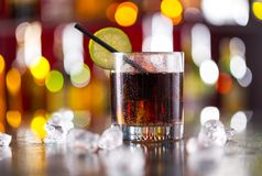 Glass of cola drink on bar counter Royalty Free Stock Images