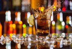 Glass of cola drink on bar counter Royalty Free Stock Image