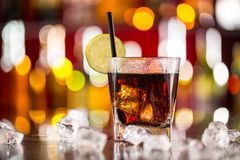 Glass of cola drink on bar counter Stock Photo