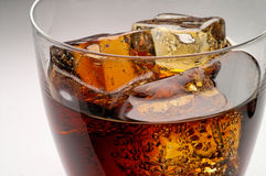 Glass of cola drink with ice c. Loseup (1 Royalty Free Stock Photography