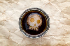 Glass of cola drink with skull shape ice Royalty Free Stock Photo