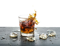 Glass cola drink with splash. Food and beverages Royalty Free Stock Photography
