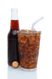 Glass of Cola with Drinking Straw and Bottle Royalty Free Stock Photography