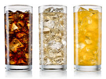 Glass of cola, fanta, sprite with ice cubes isolated on white. W Royalty Free Stock Photos