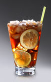 Glass with cola and ice. On gray background Stock Image