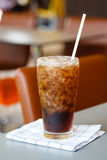 Glass of cola with ice Stock Images