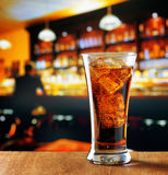 Glass of cola with ice in a bar Royalty Free Stock Image