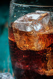 Glass of cola with ice. Close-up Royalty Free Stock Photos
