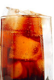 Glass with cola and ice cubes Royalty Free Stock Images