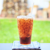 A glass of cola with ice cubes Royalty Free Stock Photo