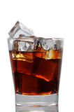 Glass with cola and ice cubes. On white background Stock Images