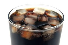Glass of cola with ice cubes royalty free stock images