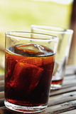 Glass of cola with ice cubes Royalty Free Stock Image