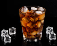 A glass of cola with ice cubes Royalty Free Stock Photos