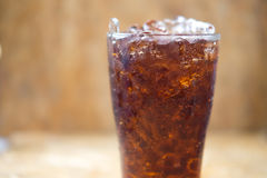 Glass of cola with ice cubes Royalty Free Stock Photography