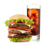 Glass of cola with ice and hamburger Stock Photos