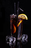 Glass of cola with ice and lemon. Royalty Free Stock Images