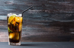 Glass of cola with ice and lime Stock Photo