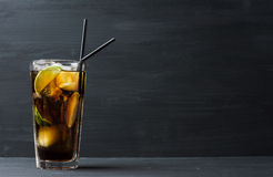 Glass of cola with ice and lime Stock Photos