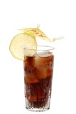Glass of cola with lemon and an umbrella Stock Image