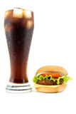 Glass of cola with lush tasty hamburger isolated on a white Royalty Free Stock Photo