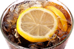 Glass of cola macro, isolated on white. Macro photo of glass of cola with lemon, shallow depth of field image Stock Image