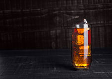 Glass of cola soda with ice cubes on wooden board. Background Royalty Free Stock Photography