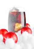 Glass of cola soda  on snow and christmas balls Stock Photography