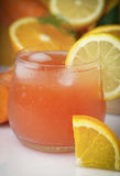 Glass of cold ACE juice Stock Photography