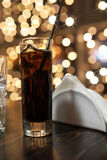 Glass of cold alcohol drink with ice on table Royalty Free Stock Images