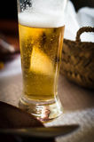 Glass of Cold Beer. At a cafe royalty free stock image