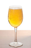 Glass of cold beer over wooden surface Royalty Free Stock Photography